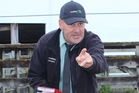 Carrfields Livestock agent Phill Robson selling rams at the Dannevirke Saleyards last Thursday.