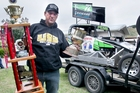 ATTITUDE: Jason Penn with the New Zealand Stockcar Championship silverware on his return from Huntly last night. PHOTO/Warren Buckland