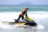 VIGILANT:  Ruakaka lifeguard Adam McKernan patrols the surf during a busy weekend for beachgoers on the Bream Bay coast. PHOTOS/MICHAEL CUNNINGHAM