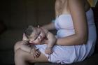 Gleyse Kelly da Silva holds her daughter Maria Giovanna as she sleeps in their house in Recife, Pernambuco state, Brazil. Photo / AP