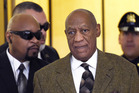 Bill Cosby arrives for a court appearance in Norristown aided by a bodyguard. Photo/AP