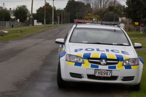 Police car looking down the road in Goring St, Opotiki. Photo / File