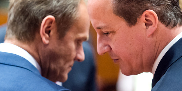 European Council President Donald Tusk, left, speaks with British Prime Minister David Cameron. Photo / AP
