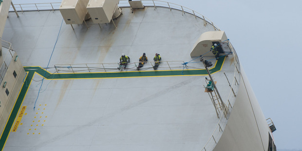 Rescue workers make their way onto the deck of the cargo ship. Photo / AP
