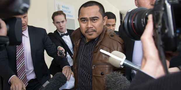 Muhammad Rizalman runs the media gauntlet after a court appearance in 2014. Photo / Getty Images