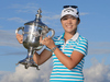 Lydia Ko of New Zealand poses with the Rolex Player of the Year trophy. Photo / Getty Images