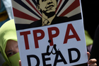 A Malaysian activist holds a placard denouncing the TPPA during a protest in Kuala Lumpur. Photo / Getty Images