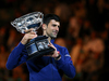 Novak Djokovic of Serbia holds the Norman Brookes Challenge Cup after winning the Men's Singles Final over Andy Murray of Great Britain. Photo / Getty Images