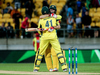 John Hastings hugs teammate Mitchell Marsh after the pair guided Australia to victory. Photo / Getty