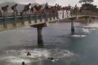 A video uploaded to Facebook shows dozens jumping into a waterway from a local footbridge, one after the other in what is described as a