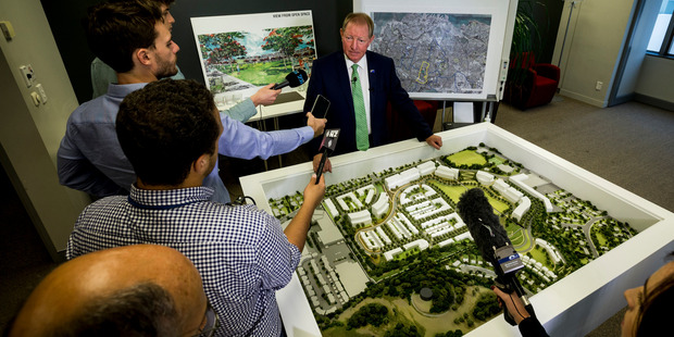 Dr Nick Smith addresses the media during a press conference about legal proceedings over appeals lodged against the $1.2 billion redevelopment of the Three Kings quarry. Photo / Dean Purcell