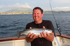 Mike Baker caught his first trout while fishing on Lake Taupo. Photo / Geoff Thomas