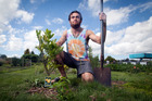 Liam Marsh is planting fruit trees to give back to the community before heading overseas. Photo / Andrew Warner