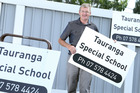 Kaka St Special School has been renamed as Tauranga Special School. Principal Barrie Wickens shows off the school's temporary signs. Photo / John Borren