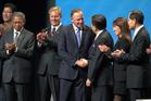 John Key shakes hands with Mexico's Ildefonso Guajardo. Photo / Nick Reed