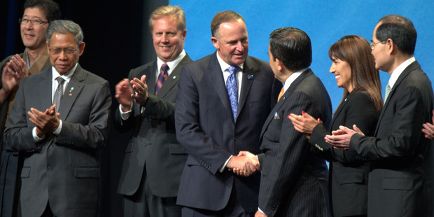 John Key shakes hands with Mexico's Ildefonso Guajardo. Photo / Nick Reed