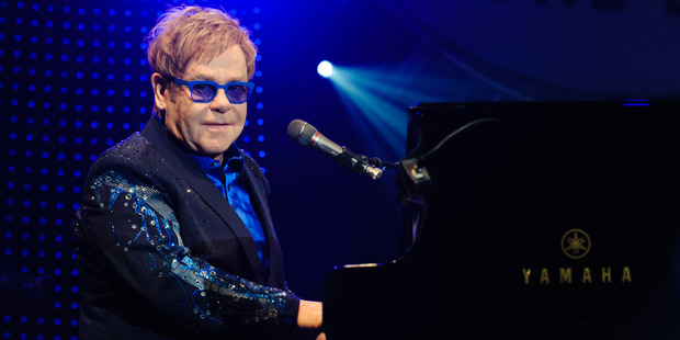 Elton John wants to slow down his career over the next few years to make the most of family.