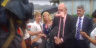 Steven Joyce had a dildo hurled at his face by anti-TPP protester Josie Butler. Photo / NEWSHUB