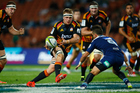 Sam Cane of the Chiefs makes a break during the round eight Super Rugby match between the Chiefs and the Bulls at Waikato Stadium. Photo / Getty Images