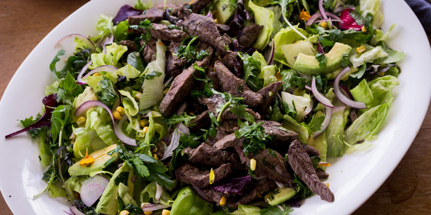 Simple steak salad with herby dressing. Photo / Dean Purcell