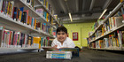 Krish Mani, 7, is almost ready to move on to chapter books, his mother says. Photo / Brett Phibbs