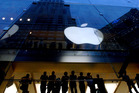 Apple derives considerable benefit from the infrastructure and subsidies Australian taxpayers provide. Photo / Bloomberg