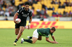 Akira Ioane of New Zealand beats the tackle of Kwagga Smith of South Africa during the 2016 Wellington Sevens cup final match between New Zealand and South Africa. Photo / Getty Images.