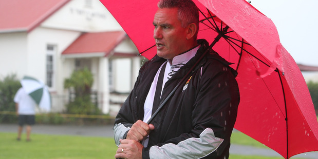 Labour MP Kelvin Davis at Ti Tiii in what is a wet start to Waitangi celebration for 2016.