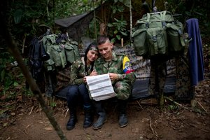 Images of female Farc soldiers cuddling their male companions and bathing in creeks were part of an effort to 'humanise' the group's fire fighters, say members of Colombia's police force. Photo / AP.