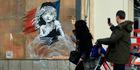 Banksy gives tear gas use a spray