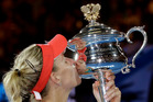 Angelique Kerber of Germany kisses the trophy after defeating Serena Williams of the United States in the women's singles final at the Australian Open. Photo / AP.