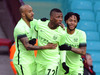 Manchester City's Kelechi Iheanacho, center, celebrates scoring with teammates Raheem Sterling, right, and Fabian Delph during the English FA Cup fourth round. Photo / AP.