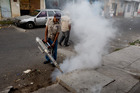A health ministry worker fumigates for Aedes aegypti mosquitoes at the Bethania neighborhood in Guatemala City. Photo / AP