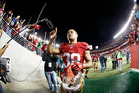 In this photo taken with a fisheye lens, San Francisco 49ers running back Jarryd Hayne (38) waves to fans after an NFL preseason football game. Photo / AP