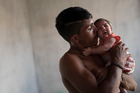Dejailson Arruda holds his daughter Luiza at their house in Brazil. More than 2,700 babies have been born in Brazil with microcephaly this year. Photo / AP