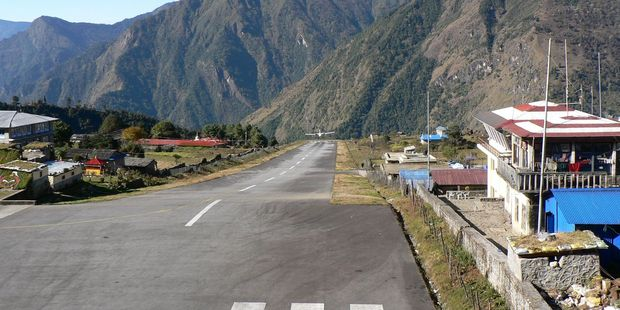 Lukla Airport in Nepal is a nail-biting experience with a cliff at the end of the runway. Photo / Jim Eagles