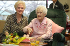 Rona McCarthy cuts the cake on her 99th birthday on August 21 with her only daughter Karin Campbell.