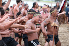 The Waitangi Day waka pageant and the paddlers' mass haka on Tii Beach is one of Northland's great spectacles. PHOTO /Michael Cunningham