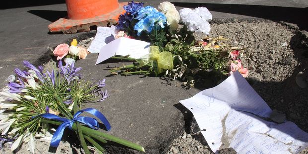Flowers left at the crash site on Masterton's Queen St. Photo / Andrew Bonallack