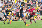 A full house watches as Crusaders first-five Dan Carter looks for a gap in the Hurricanes defence during last year's Super-15 pre-season match at Eketahuna. PHOTO/CHRIS KILFORD
