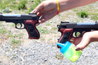 Police respond to calls of two boys pointing pistols.