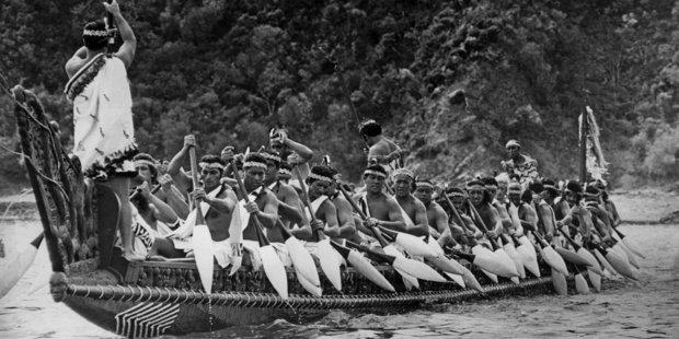 Maori warriors paddling the 117 foot waka, Nga Toki Matawhaorua in 1974.