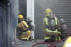 Fire crews respond to a kitchen fire at Beach Babylon Cafe. Photo: SNPA / Derek Quinn