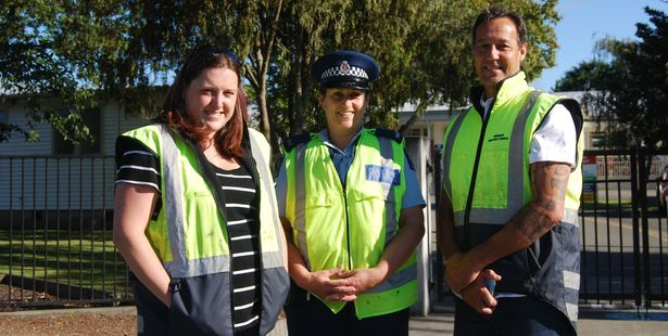Road Safety Council co-ordinator Holly McGeorge, Constable Susan Esler and Road Safety Council manager Bruce Pauling outside Douglas Park School on the first day back at school. PHOTO/ALISA YONG