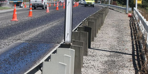 Stones from sealing works are scattered across the Waingawa Bridge south of Masterton. PHOTO/ANDREW BONALLACK