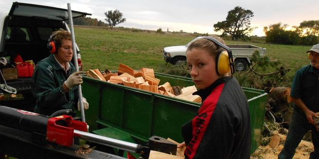 Ruth Sutherland, left, and daughter Siobhan using the wood splitter stolen from a paddock in Lees Pakaraka Rd on Monday night. PHOTO/SUPPLIED