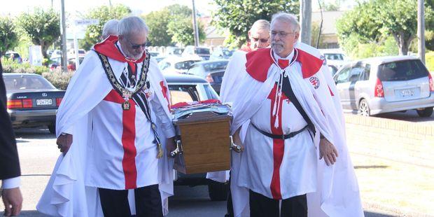 Knight Masons, in full regalia, carry Mr Haglund's casket. PHOTO/ANDREW BONALLACK