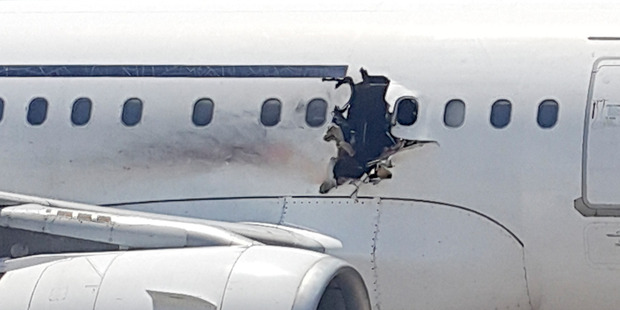 The suspected bomber is thought to be the man who was sucked out of the plane after blowing a hole in the fuselage. Photo / AP