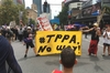 OPPOSITION: Members of the Tauranga TPP Action Network marching down Queen St, Auckland, to protest the signing of the TPPA. PHOTO/SUPPLIED