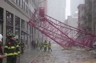 Firefighters assess NYC crane collapse damage